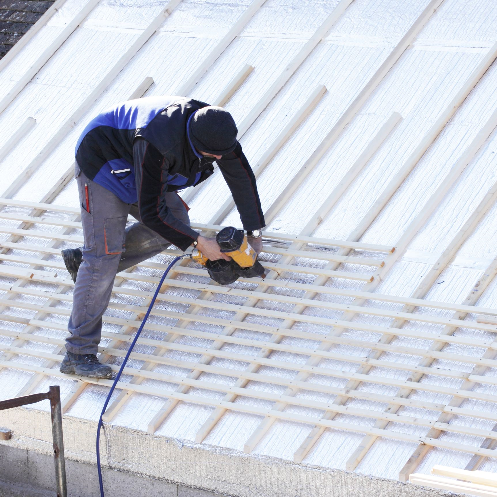 A roofer repairing a commercial roof.
