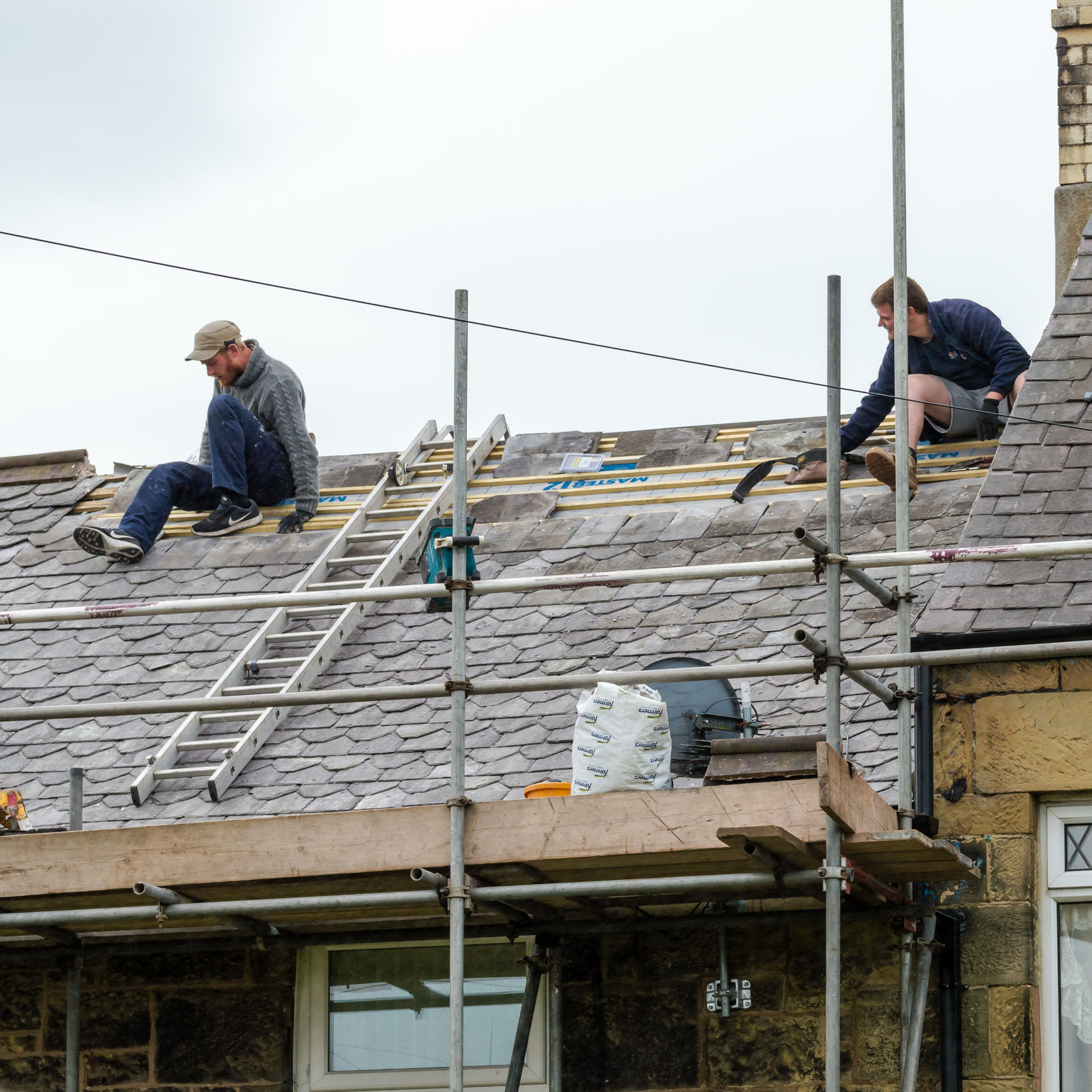 Roofer in the process of restoring a roof