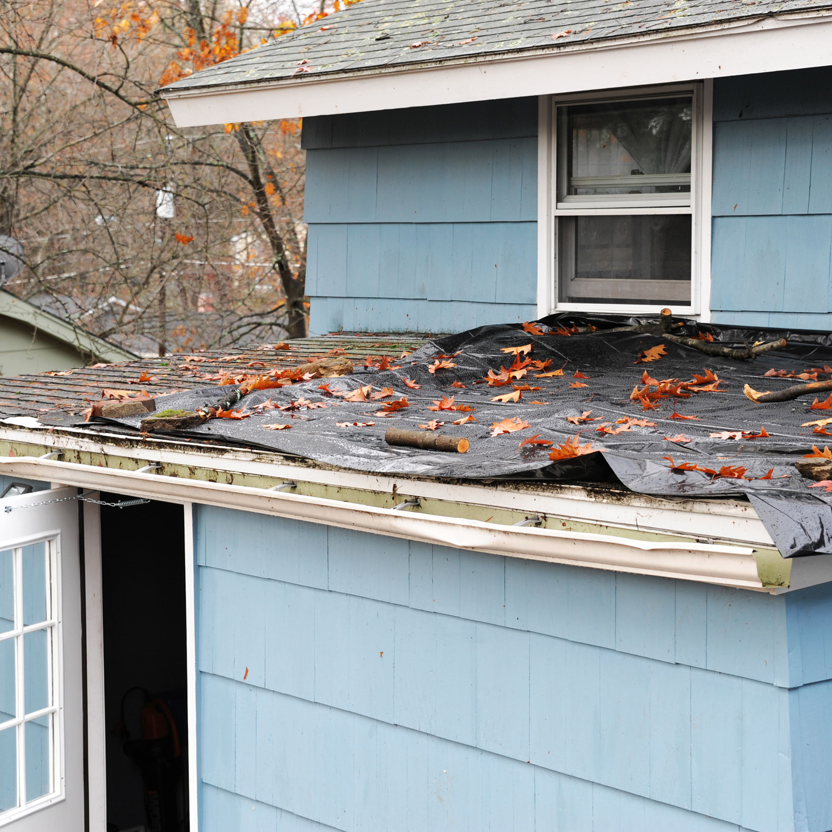 A roof damaged by a strong wind