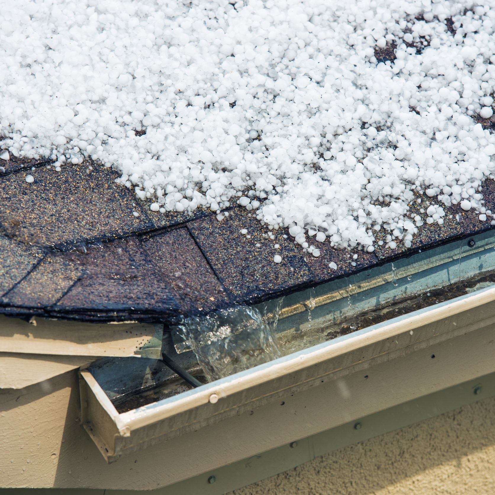 hail piled up on a roof