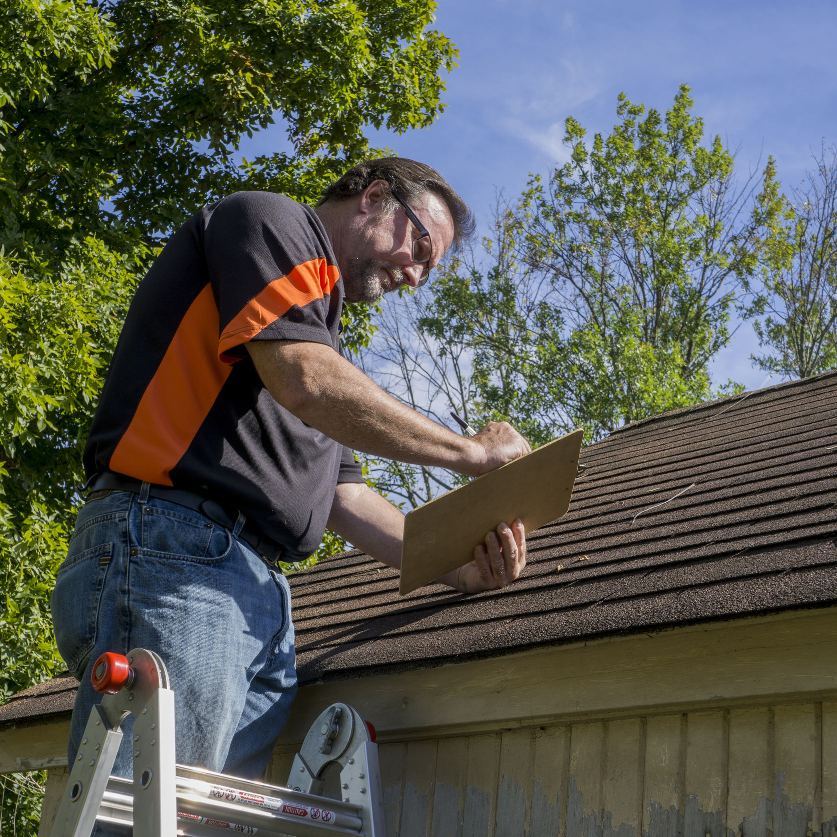adjuster checking roof