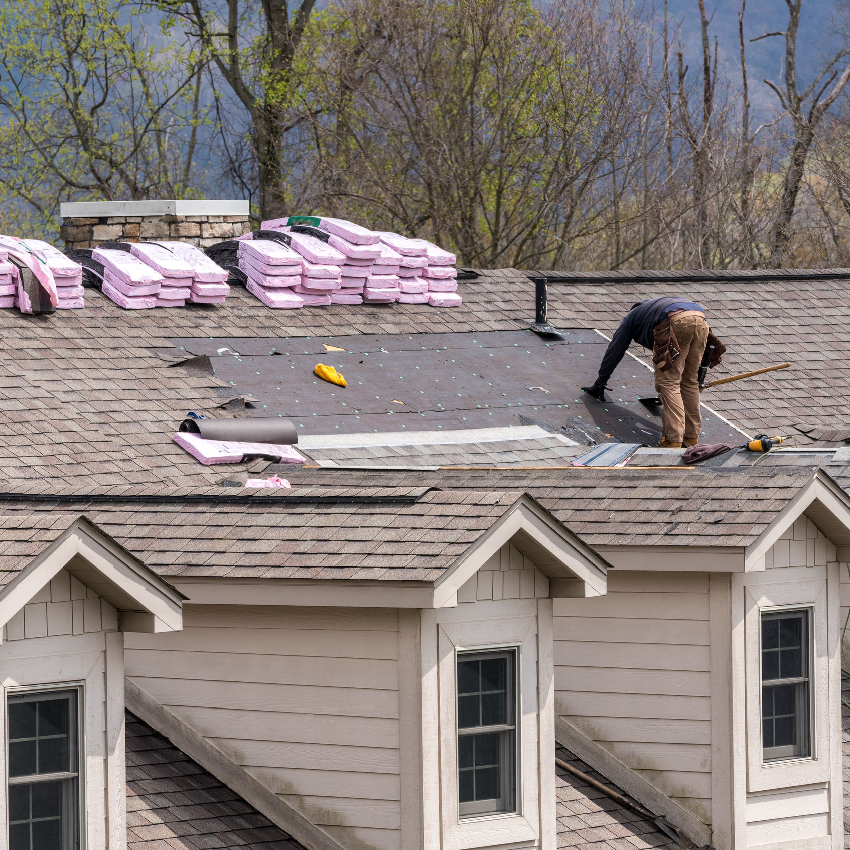 A roofer installing a roof